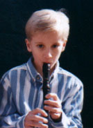 child playing soprano recorder